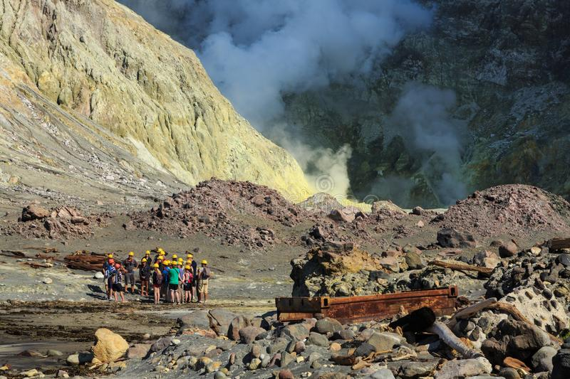 White Island, New Zealand. Tourists in a landscape of volcanic steam and sulfur stock image