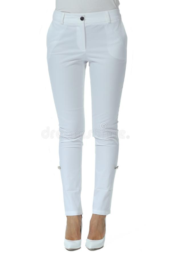 White jeans trousers on model legs with white stiletto heels. With bare toes royalty free stock photography
