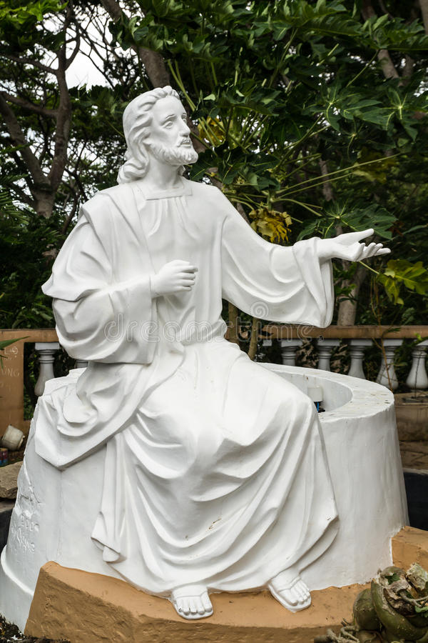 White Jesus statue. In front of church stock image