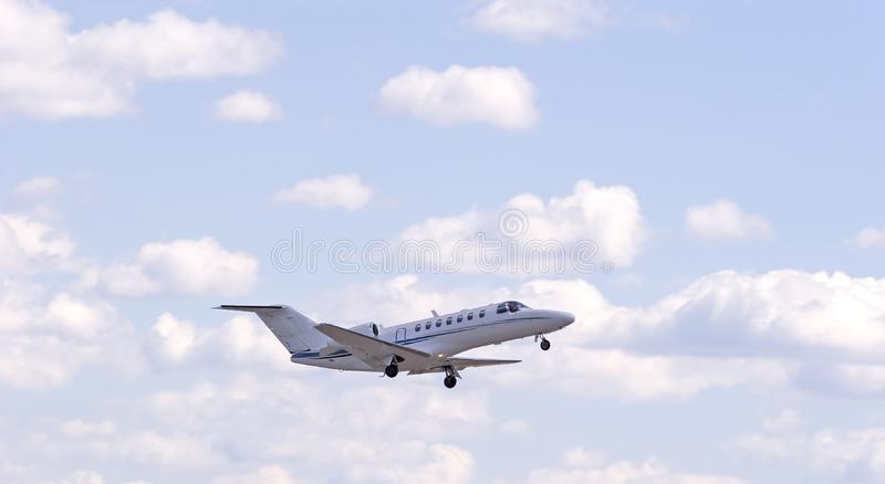 White Jet in Clouds stock images