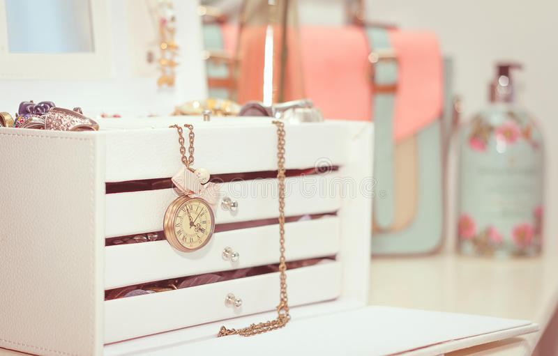 Jewelry with vintage clock and female complements in soft pastel royalty free stock photos