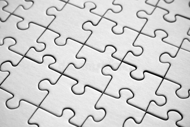 White jigsaw pattern stock photos