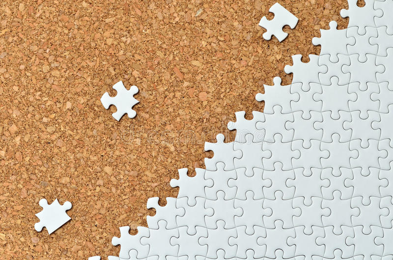 White jigsaw puzzle. (Mount in cork board) stock photos