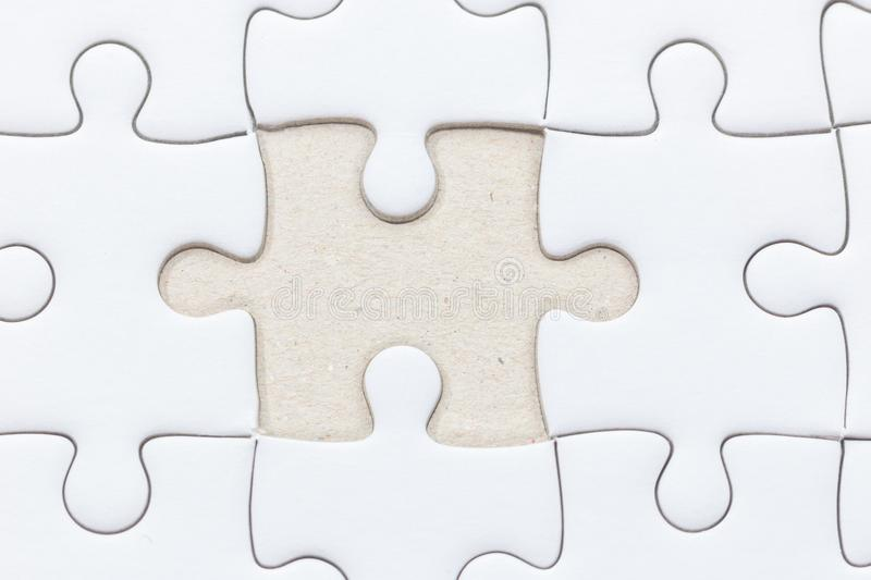 White jigsaw puzzle with missed piece royalty free stock image