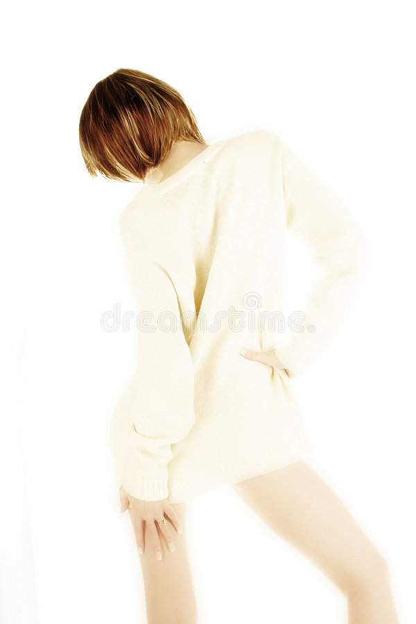 White jumper. Young woman naked under white jumper - high key stock photos