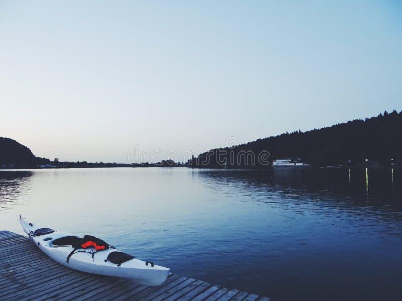 White Kayak on Brown Wooden Dock stock photo