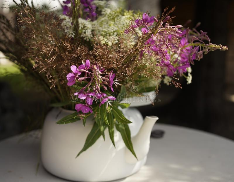 white kettle table bouquet flowers close-up outdoor royalty free stock photography
