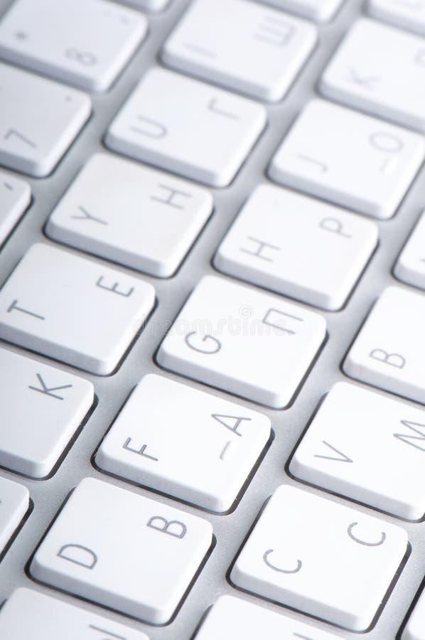 White keyboard. Macro shot of a laptop white keyboard stock photo