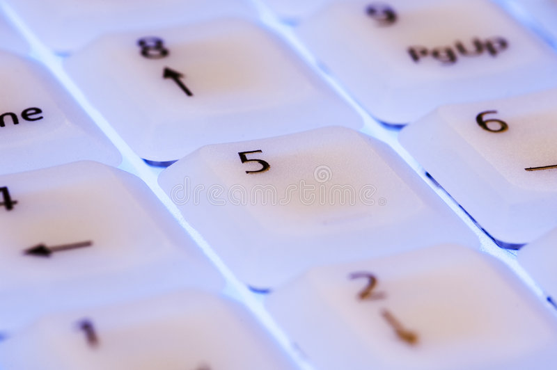 White keyboard with blue light close up
