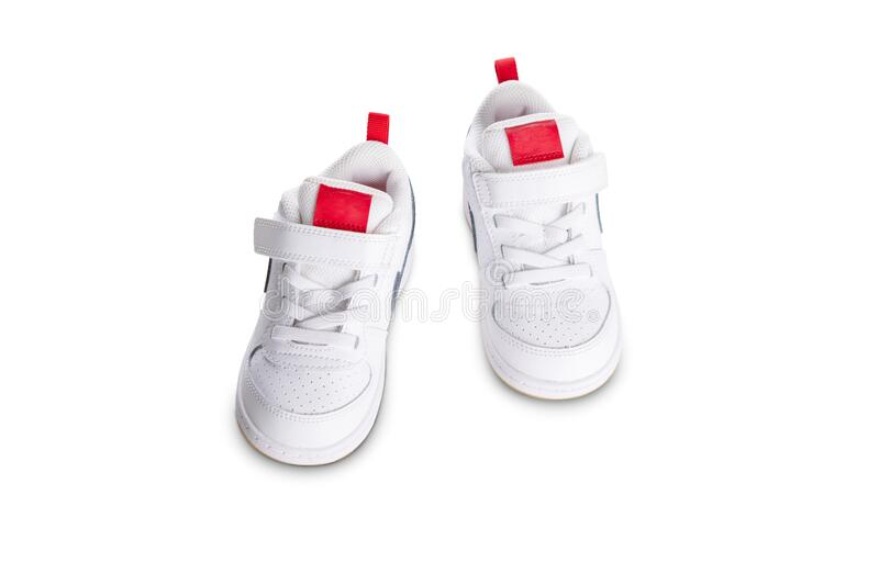 White kids sport shoes on white background royalty free stock photo