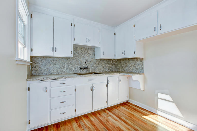 Download White Kitchen Cabinets With Light Tone Hardwood Floor Stock Image    Image: 75281381