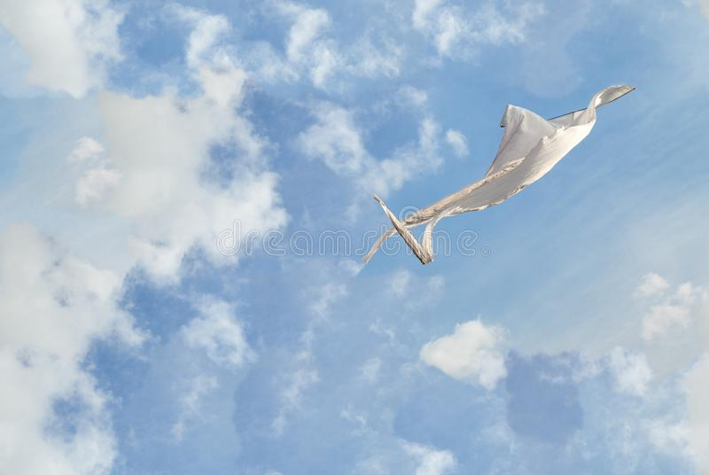 White kite flying against the blue sky full of clouds. Seamless texture background.  royalty free stock images