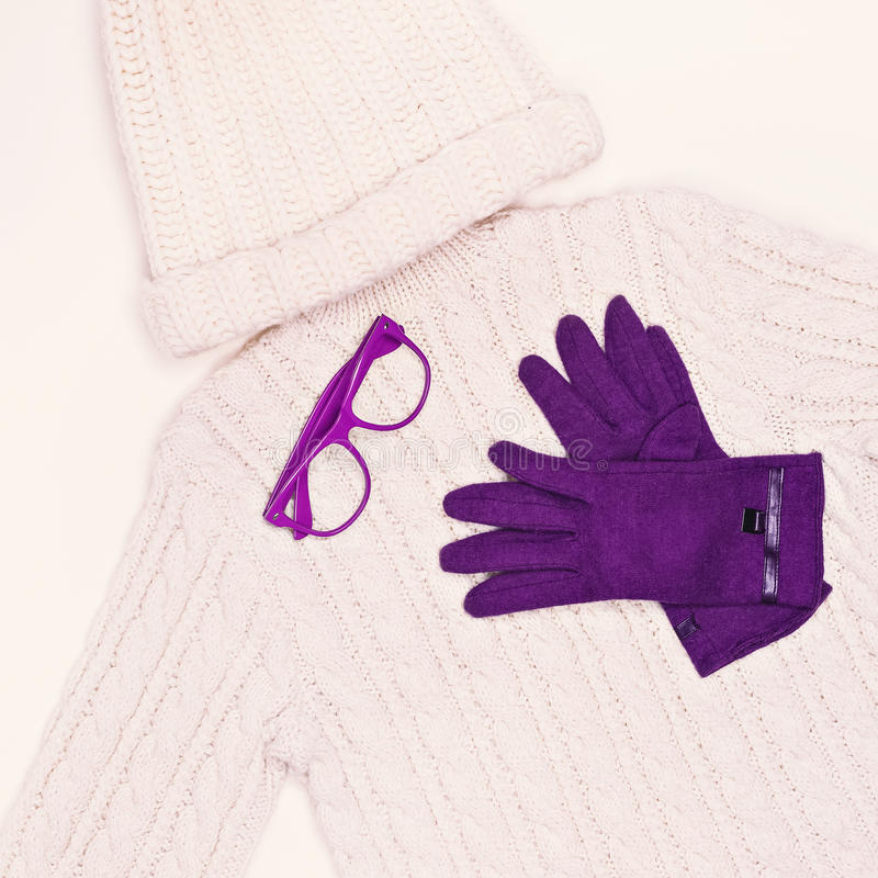 White knit sweater and cap in combination with purple gloves. Wi. Nter Fashion Style royalty free stock photography