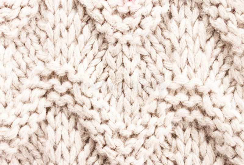 White knitting background texture. Knit woolen Fabric textile mu. Lticolor back stock image