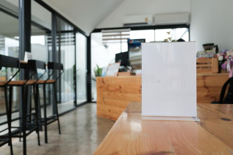 White label in cafe. display stand for acrylic tent card in coffee shop. mockup menu frame on table in restaurant. space for text. White label in cafe. display stock image