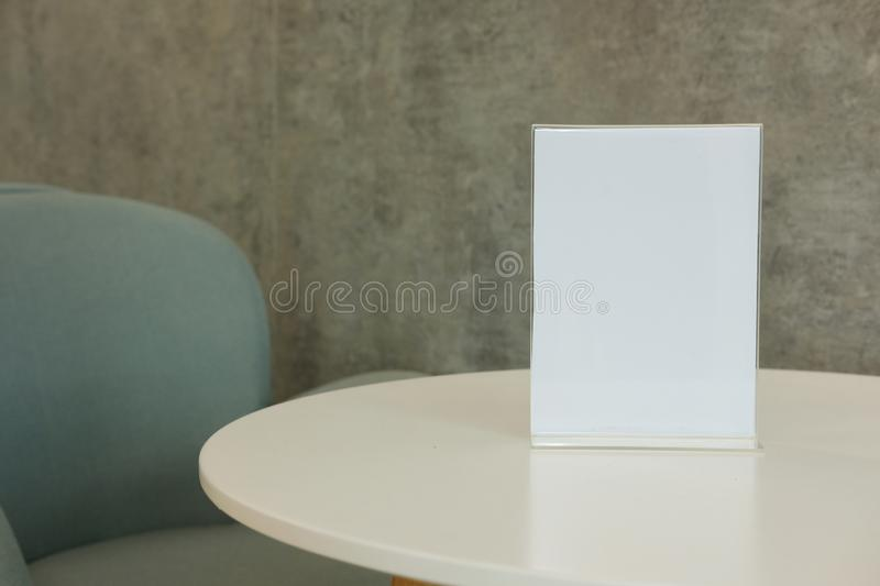 White label in cafe. display stand for acrylic tent card in coff. Ee shop. mockup menu frame on table in restaurant. space for text royalty free stock images