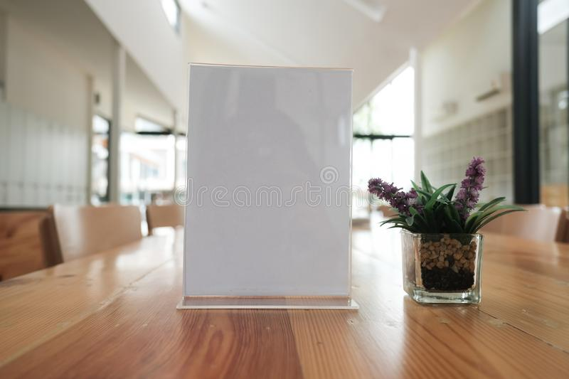 White label in cafe. display stand for acrylic tent card in coffee shop. mockup menu frame on table in restaurant. space for text. White label in cafe. display stock images