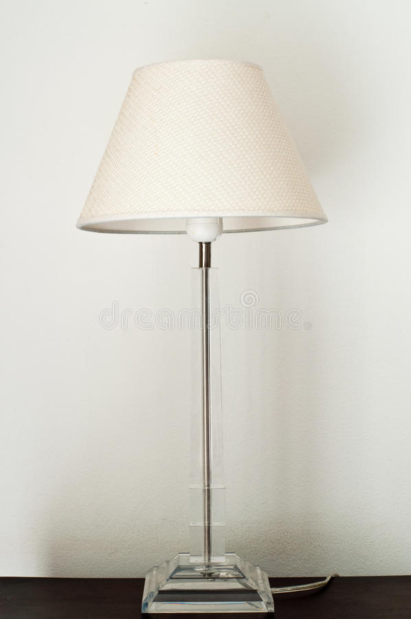 White lamp on the blown table