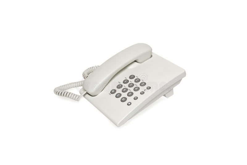 White land line phone. Isolated on a white background stock image