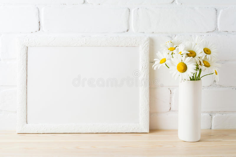 White landscape frame mockup with daisy flower in styled vase stock photo