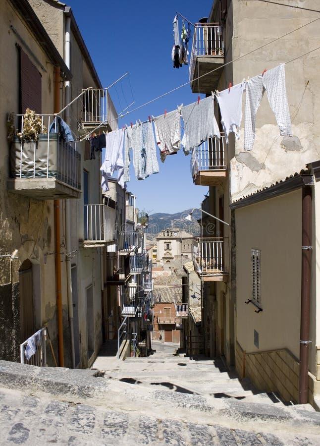 White laundry hanging to dry, Leonforte. White laundry hanging to dry on a clothes-line, Leonforte - Italy royalty free stock photo
