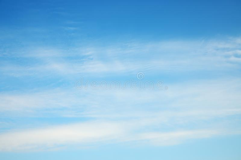 White layered fuzzy clouds at blue sky stock photos