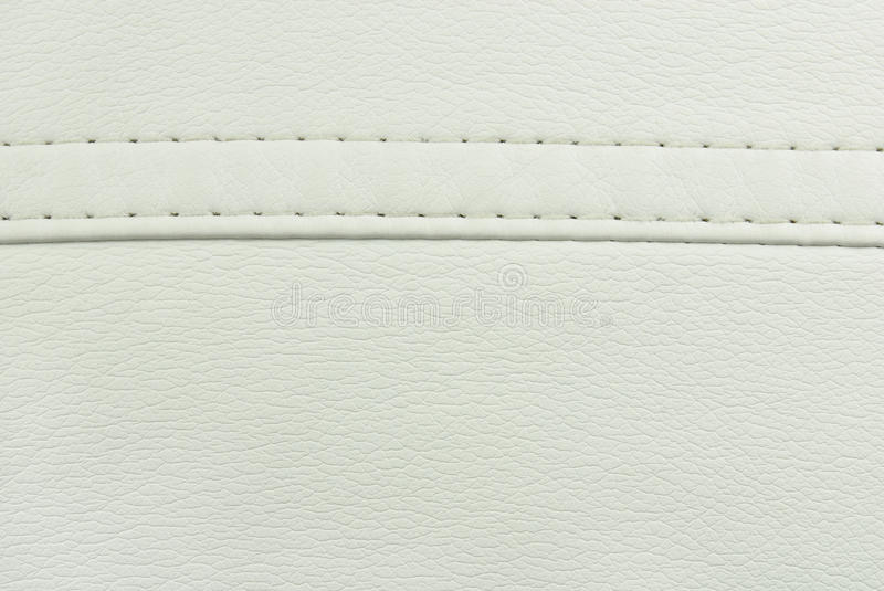 White leather seam texture. Closeup of the white leather seam texture stock image