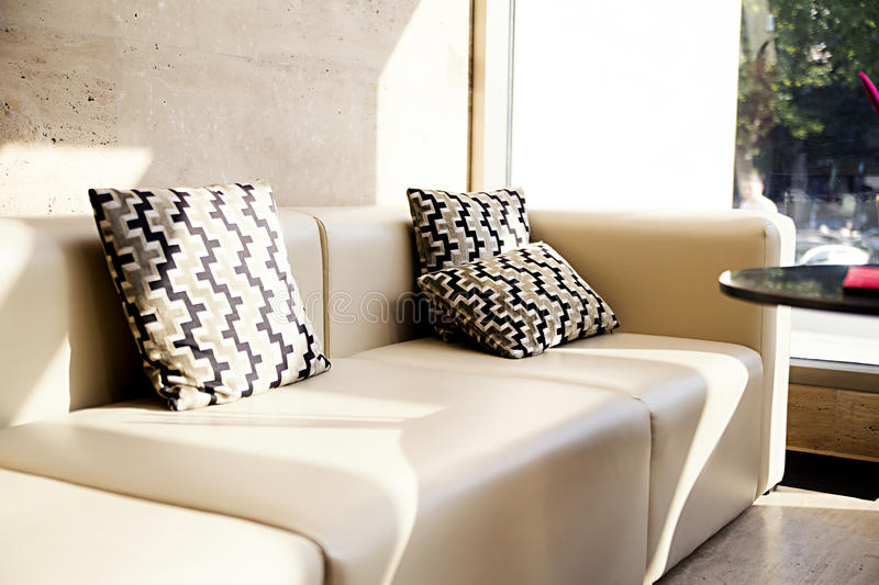 White leather sofas in the hall. Photo of White leather sofas in the hall royalty free stock photography