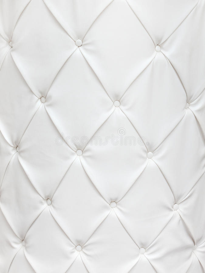White leather texture with buttons. In a pattern stock images