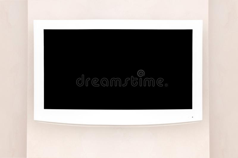 White LED TV with a black screen on a gray wall, mockup / mock up for designers. royalty free stock photography