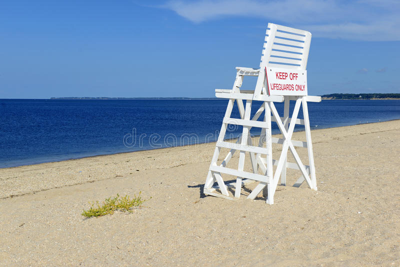 White lifeguard chair on empty sand beach with blue sky. With no people royalty free stock photos