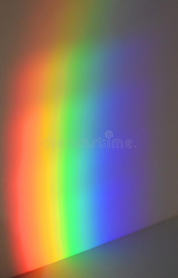 White light decomposition. Decomposition of the white light when going through a prism, where you can see some colors of the visible spectrum: red, magenta, blue stock photography