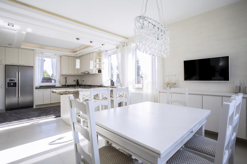 White light dining area and kitchen stock images