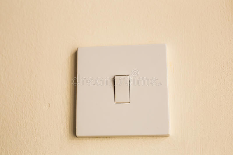 White light switch, turn on or turn off the lights.  stock photography
