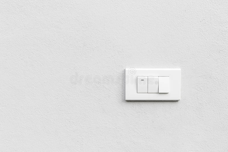 White light switches over white wall. Horizontal. White light switches over white wall. Horizontal stock photo
