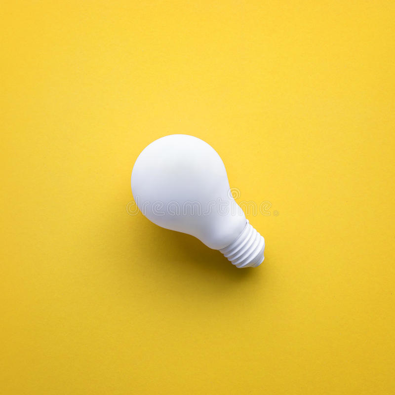 White lightbulb on color background.Ideas creativity royalty free stock photography