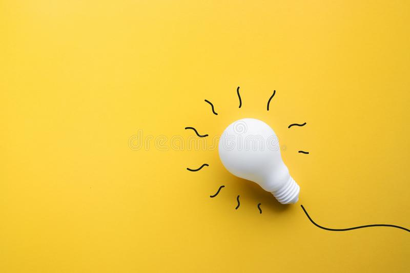 White lightbulb on pastel color background.Ideas creativity royalty free stock photography