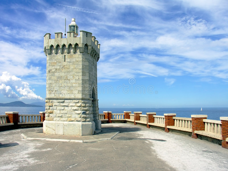 White lighthouse. Lighthouse in Piombino, Italy stock photography