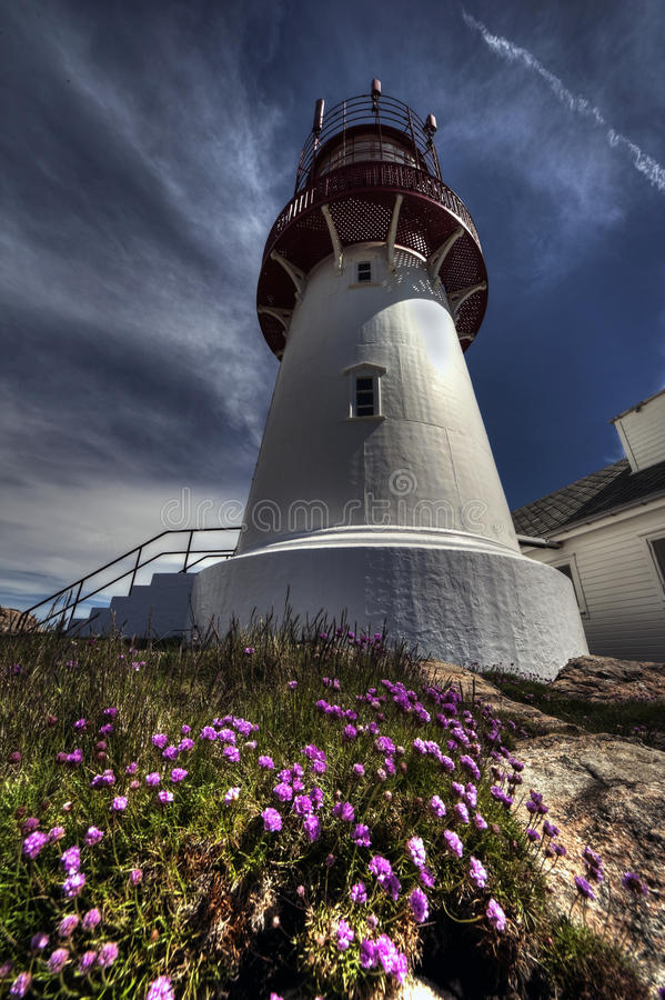 White lighthouse. Hdr photo of a white lighthouse in Norway stock photography