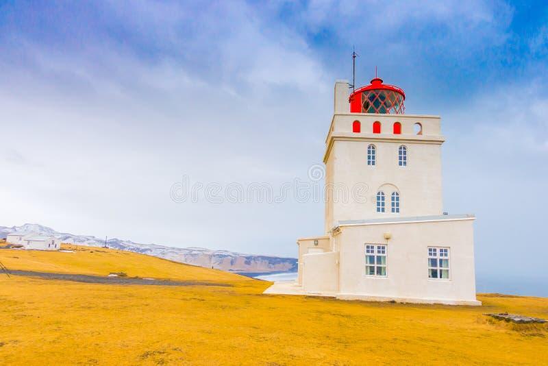 White lighthouse at Cape Dyrholaey, Iceland. . stock photo
