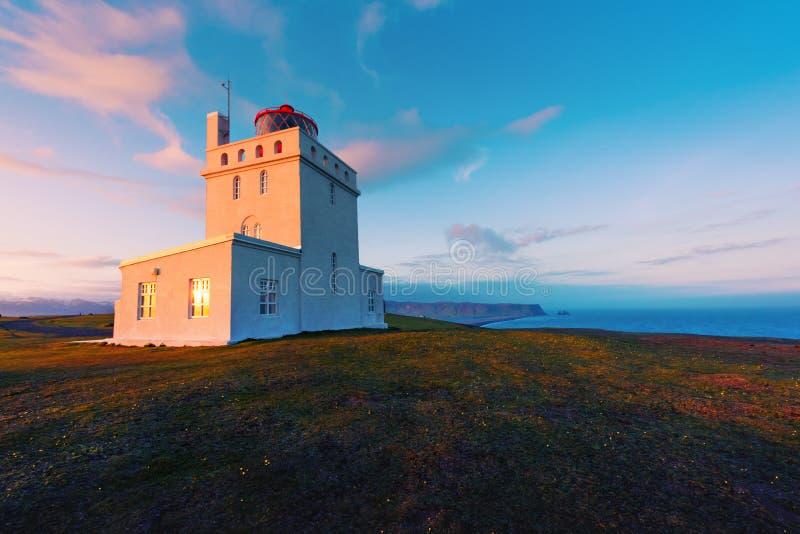 White lighthouse at Cape Dyrholaey. Iceland. Landscape photography royalty free stock image