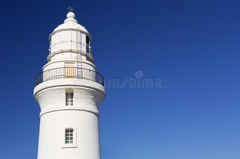 White lighthouse on a clear blue day. The bright white lighthouse of Nagata on the island of Yakushima (屋久島), Japan royalty free stock photos