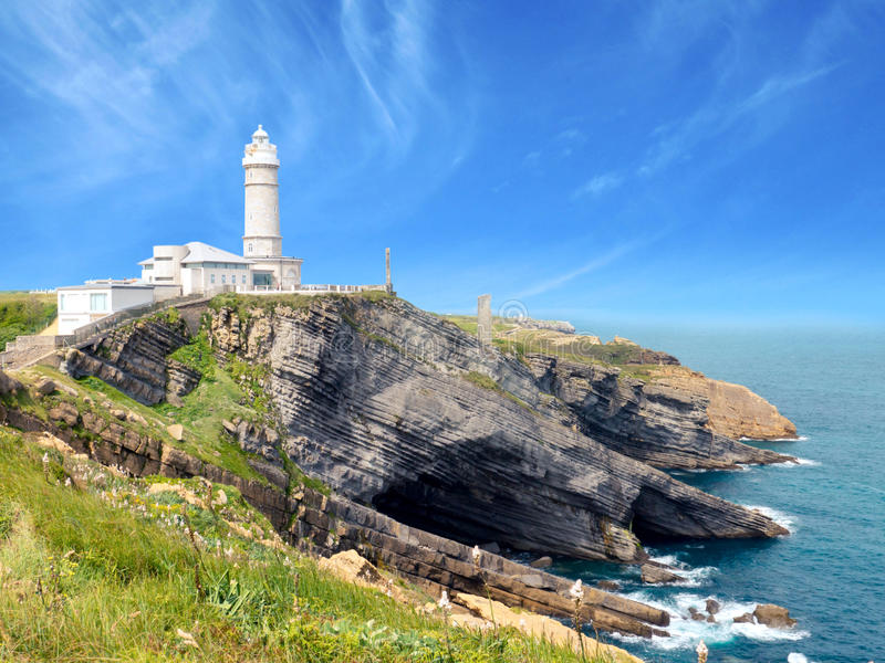 White lighthouse. On the cliff stock images