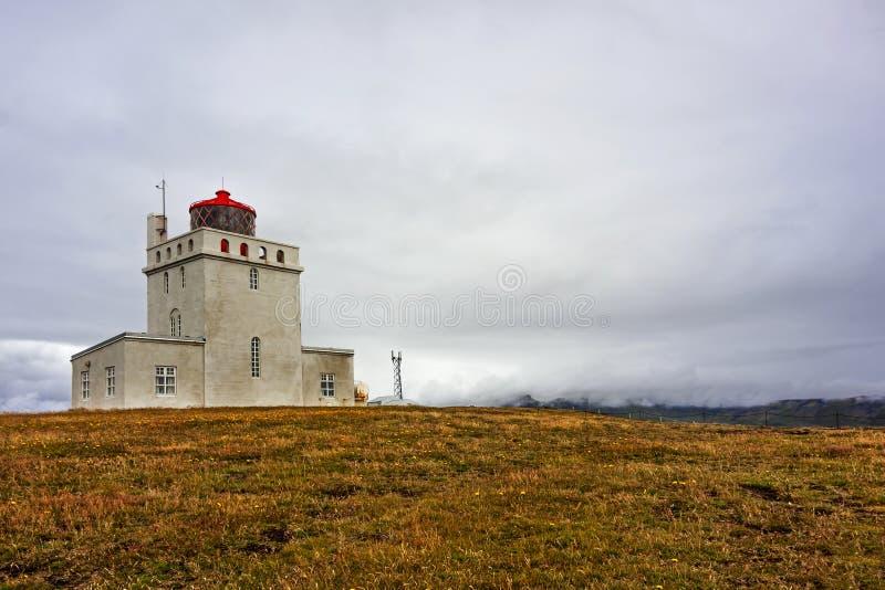 White lighthouse of Dyrholaey - Iceland. Panoramic view of white lighthouse of Dyrholaey - Iceland stock photo