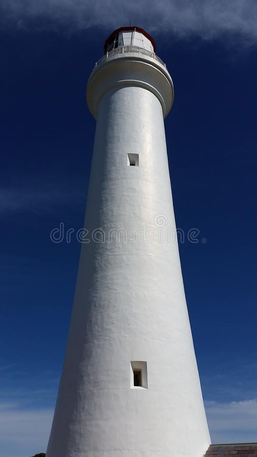 White Lighthouse in Low Angle Photography stock images