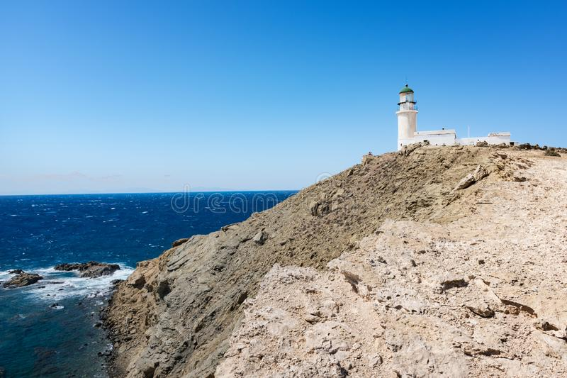 White lighthouse in Prasonisi National Park – southest spot of Island Rhodes, Greece royalty free stock images