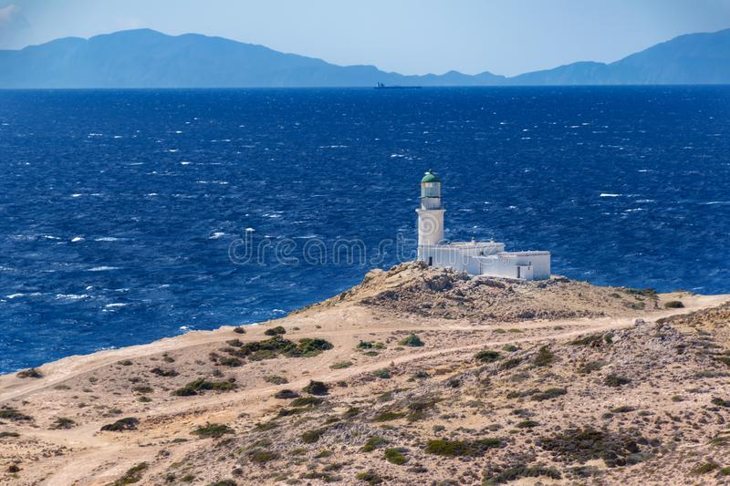 White lighthouse in Prasonisi National Park – southest spot of Island Rhodes, Greece royalty free stock photo