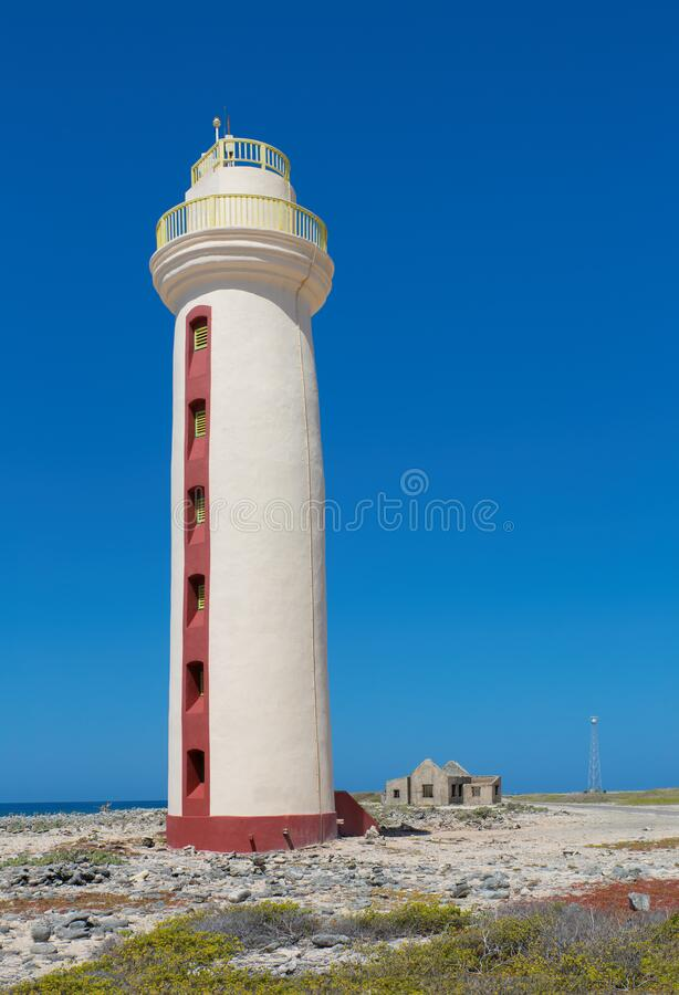 Lighthouse with ruin on coast of Bonaire royalty free stock images