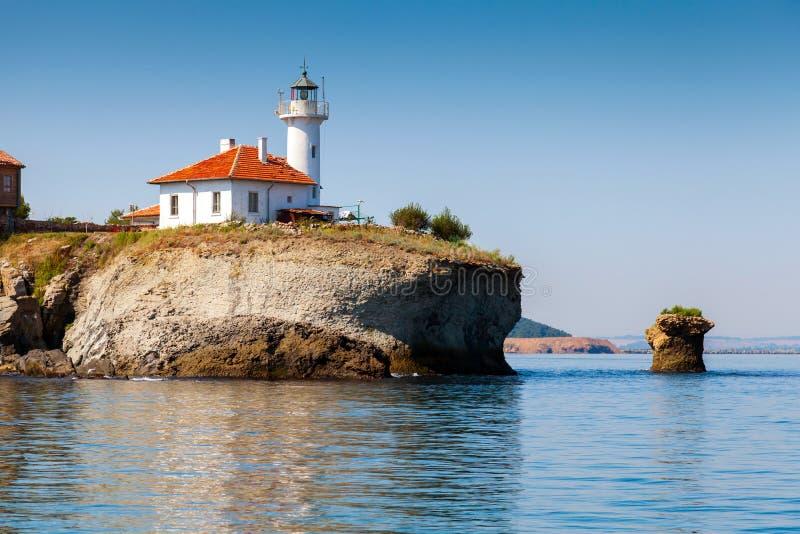White lighthouse tower on St. Anastasia Island. White lighthouse tower with red light on St. Anastasia Island. Black Sea, Bulgaria royalty free stock images