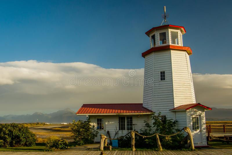 White lighthouse in town of Homer, Kenai Peninsula, Alaska. White lighthouse museum at the end of Sterling HWY royalty free stock photo